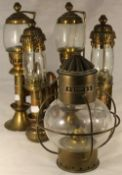 Four brass wall lights and a brass lantern