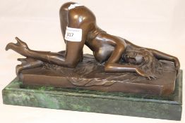 A bronze in the form of a nude female