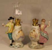 Two porcelain oil lamps