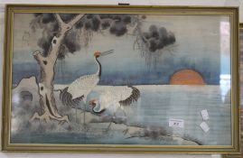 A pair of Japanese silkwork pictures each depicting birds in a landscape