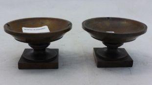 A pair of treen salts