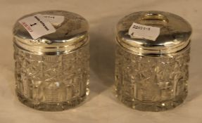 Two silver topped cut glass dressing table pots
