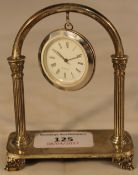A silver hanging clock
