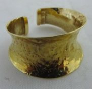 A gold Romanesque ring