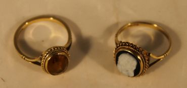 A 9 ct gold citrine ring and a 9 ct gold cameo ring