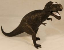 A bronze in the form of a dinosaur