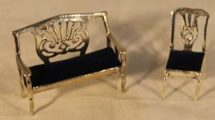 A miniature silver settee and chair