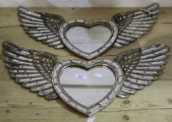 A pair of heart wing mirrors