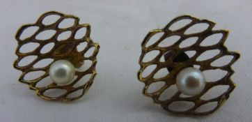 A pair of gold pearl earrings