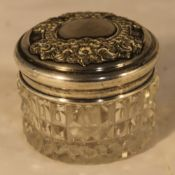 A silver topped glass jar