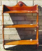 A set of mahogany shelves