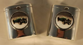 A pair of silver salt and pepper depicting vintage cars