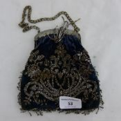 A 19th century polished steel mounted velvet evening bag