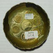 A silver coin dish