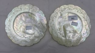 A pair of mother-of-pearl shell carvings