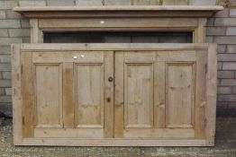 A pine fire surround and a pair of doors