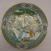 A 19th century Chinese famille verte dish with figures and key pattern border
