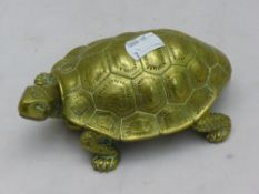 A brass inkwell formed as a tortoise