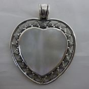 A mother-of-pearl and silver heart pendant