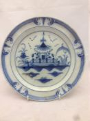 A late 18th century English pearlware plate, centrally decorated with a chinoiserie pagoda. 23.