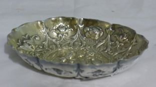 An oval silver embossed dish