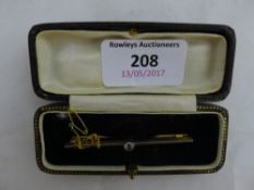 A 9 ct gold and diamond bar brooch