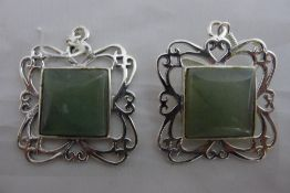A pair of jade and silver earrings