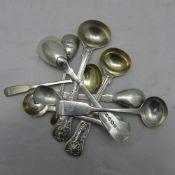 Nine assorted salt/mustard spoons