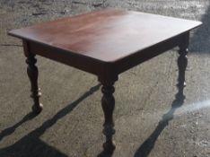 A mahogany topped table