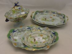 Three chinoiserie decorated ironstone platters and a small tureen on stand