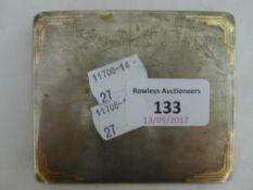 A silver cigarette case enclosing an erotic scene