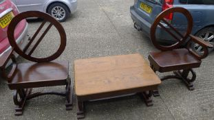 A suite of Art Deco furniture, comprising of two armchairs and a coffee table,
