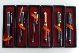 A collection of fountain and ball point pens