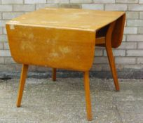 A G-Plan drop leaf dining table