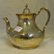 A Victorian silver teapot, London 1859,