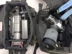 Two vintage video cameras, lenses,