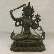 A bronze seated deity