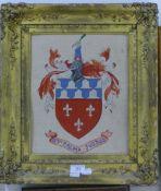 A gilt framed needlework armorial