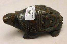 A stone model of a tortoise