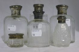 Six silver top bottles