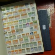 A large collection of British and Commonwealth stamps (thirteen albums)