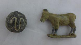 An unusual terracotta bead,