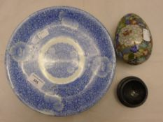 A blue and white plate and a cloisonne egg