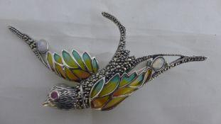 A silver plique-a-jour bird brooch