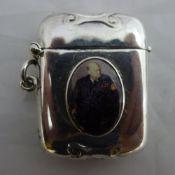 A silver vesta depicting Winston Churchill
