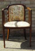 An Edwardian tub chair