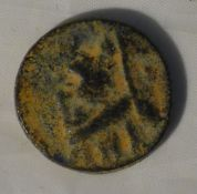 A possibly antique struck coin with Roman head