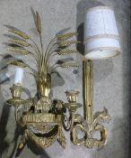 A carved gilt wood wall light