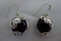 A pair of silver and amethyst earrings