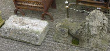 A composite stone lion and a stone plinth